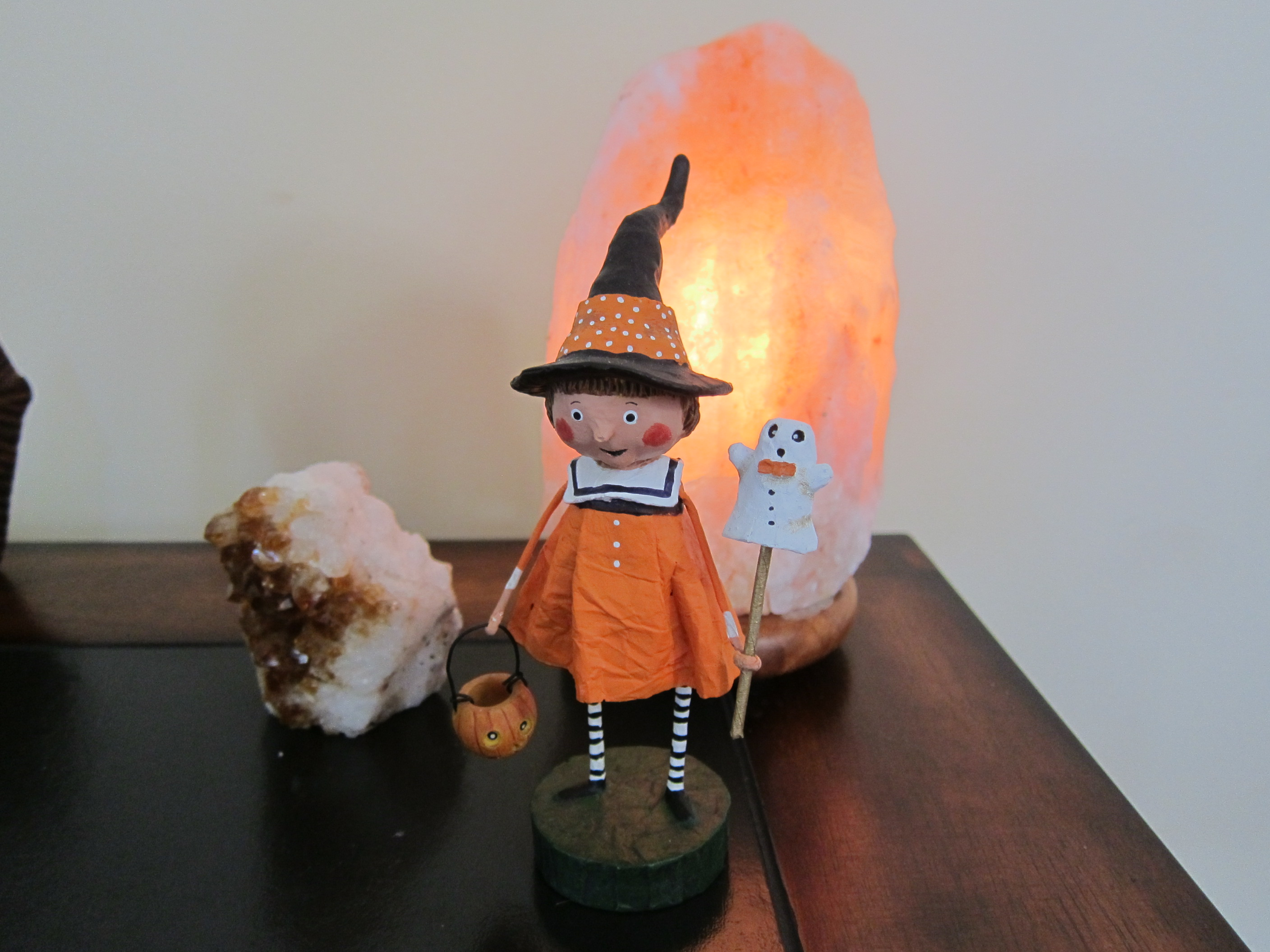 Tiny Witch watches over the room.
