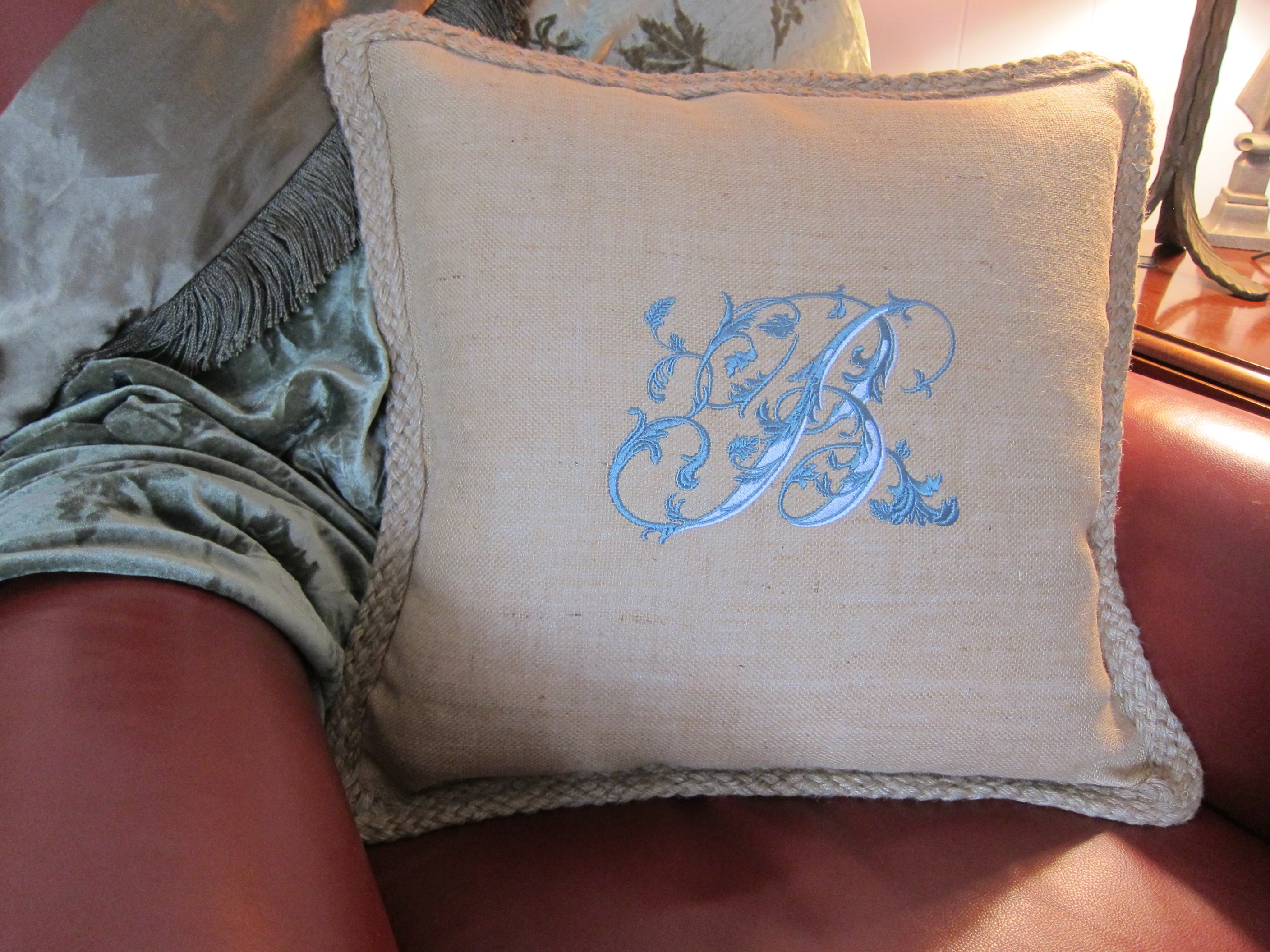 Embroidered Pillow on Chair