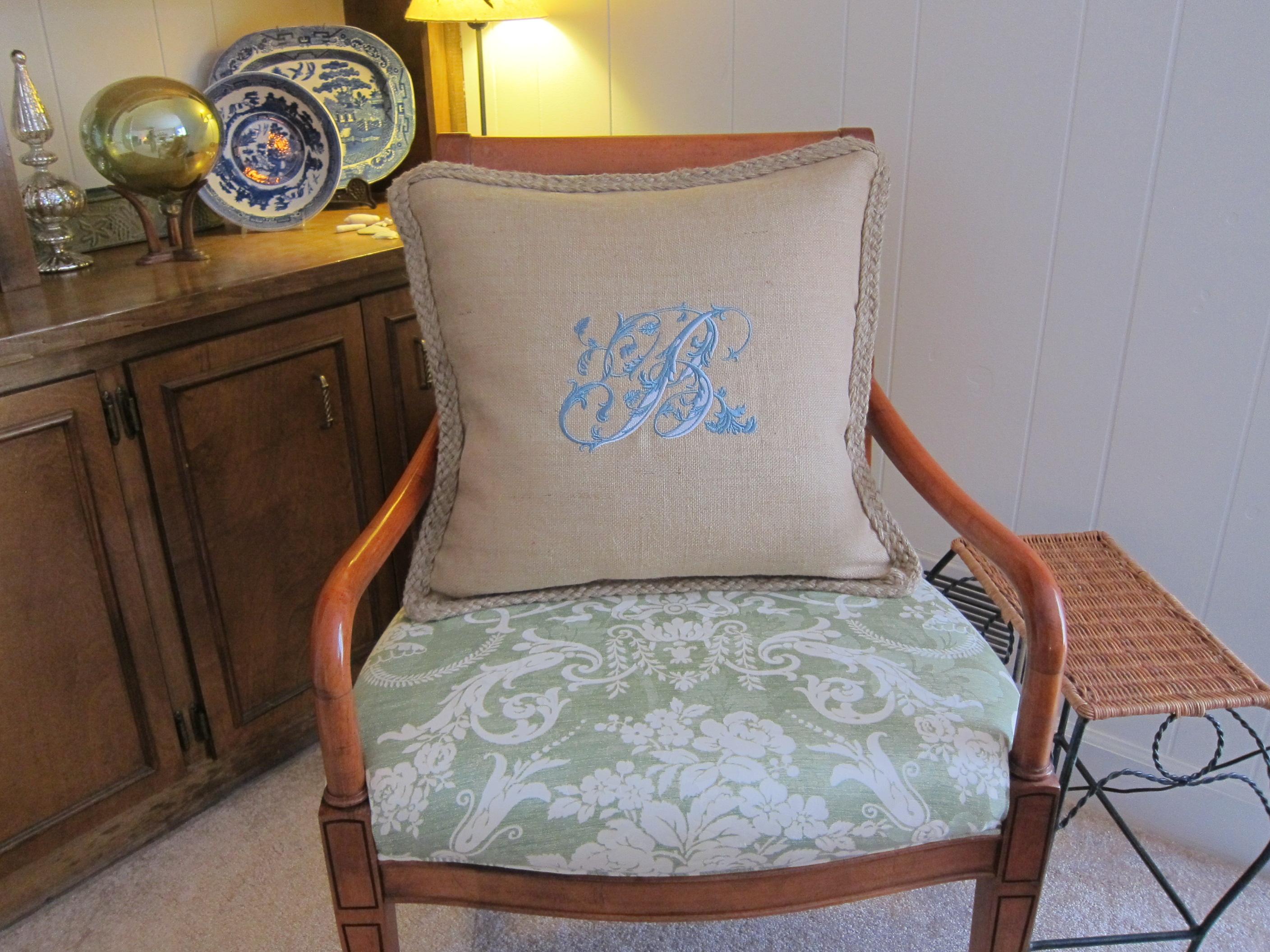 Embroidered Pillow on Green Chair